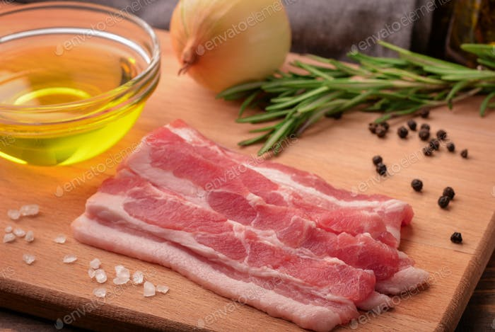 Sliced raw bacon, olive oil, spices and herbs