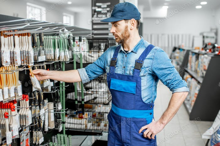 Man in workwear in the building supermarket