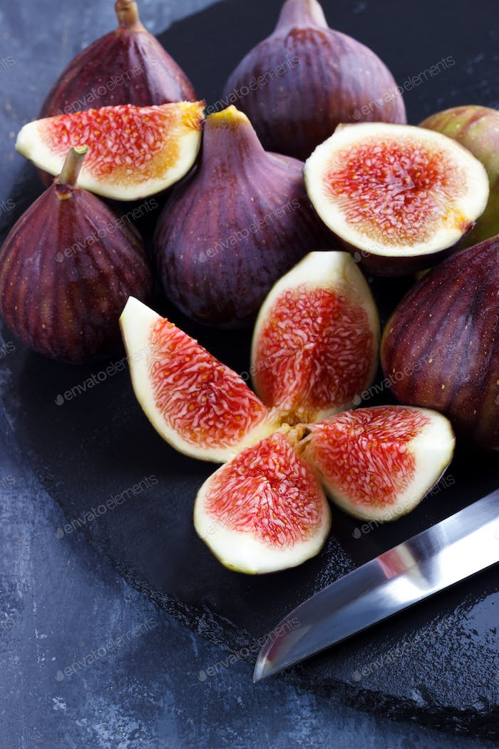 Ripe figs on cutting board