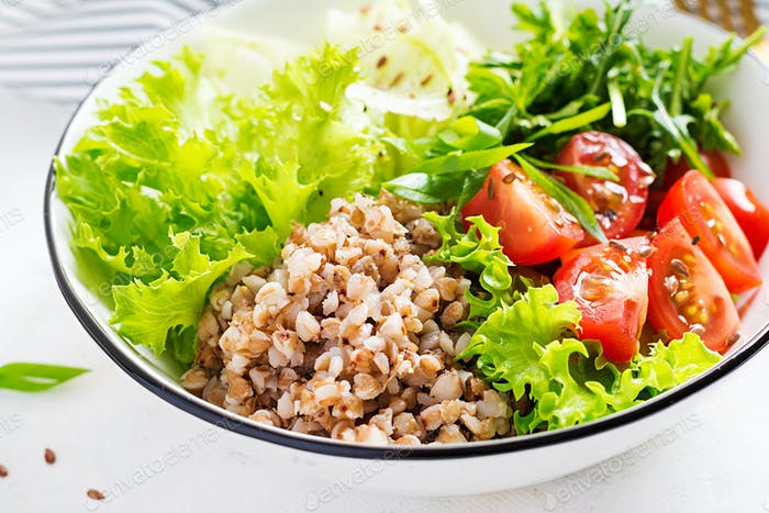 Buckwheat salad with cherry tomatoes, daikon, red onion and fresh herbs.