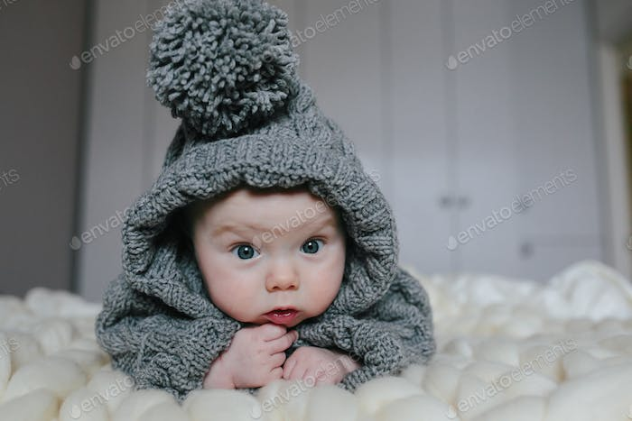Small baby in knitted clothes