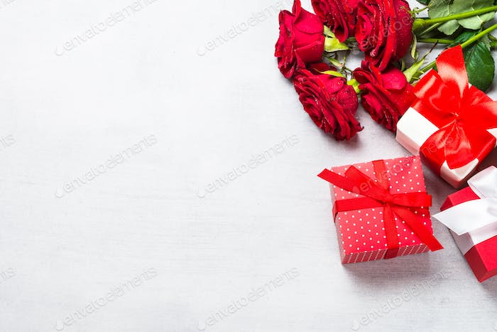 Holiday background with present and flower.
