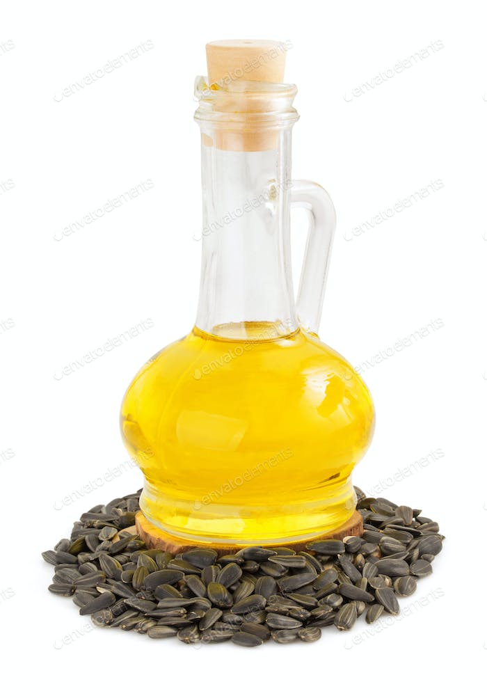 sunflower oil and seeds isolated at white