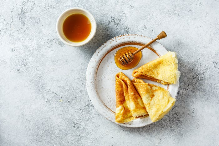 Traditional russian pancakes with honey