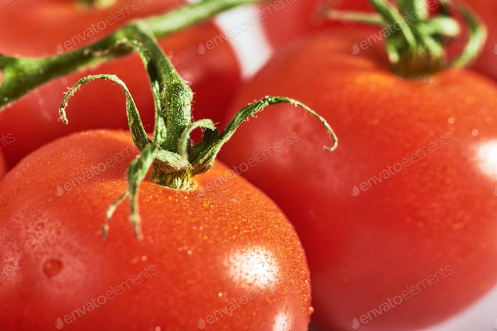 Delicious tomatoes on a chopping board