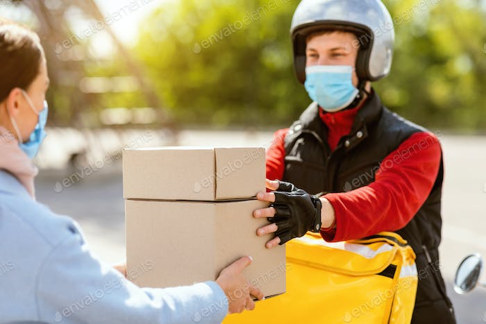 Courier In Medical Mask Giving Lunch Boxes To Girl Outdoor