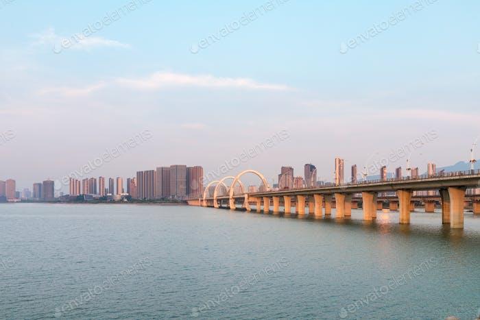 beautiful jiujiang city landscape ,lake and bridge in sunset,  China