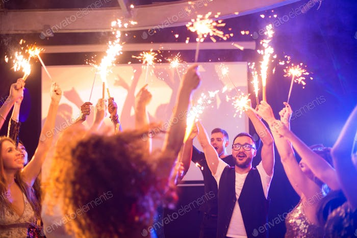 People with Sparklers Enjoying Party