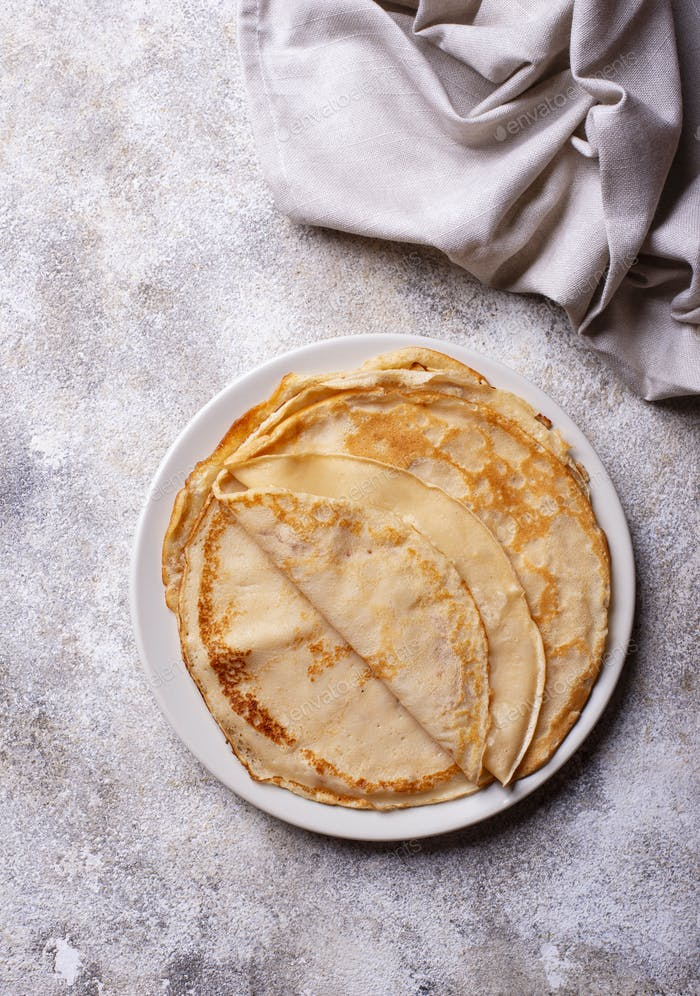 Pancakes crepes on light background