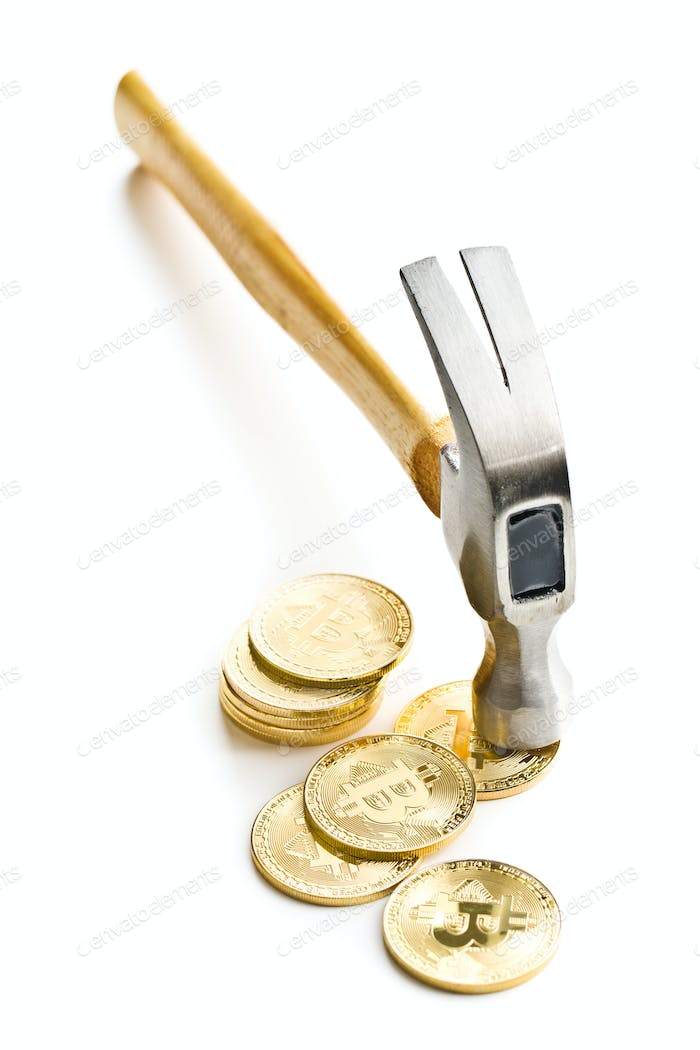Golden bitcoins and hammer.