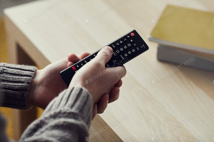 Man Holding Remote Close up