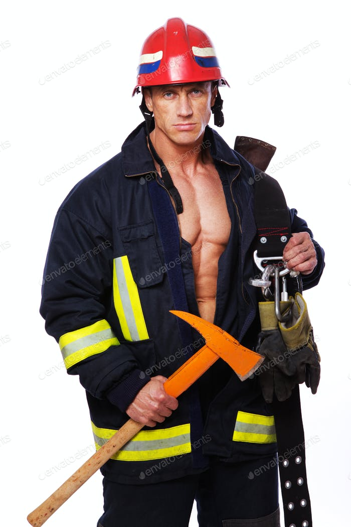 Portrait of muscle man in fireman uniform