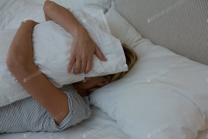 Woman sleeping peacefully on bed