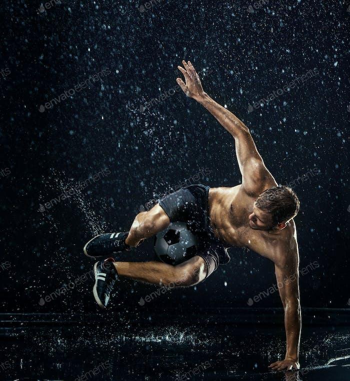 Water drops around football player under water