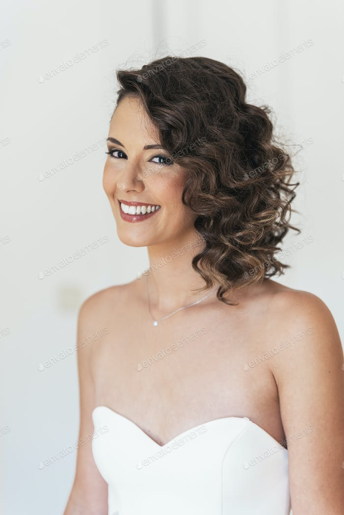 Bride trying on wedding dress.