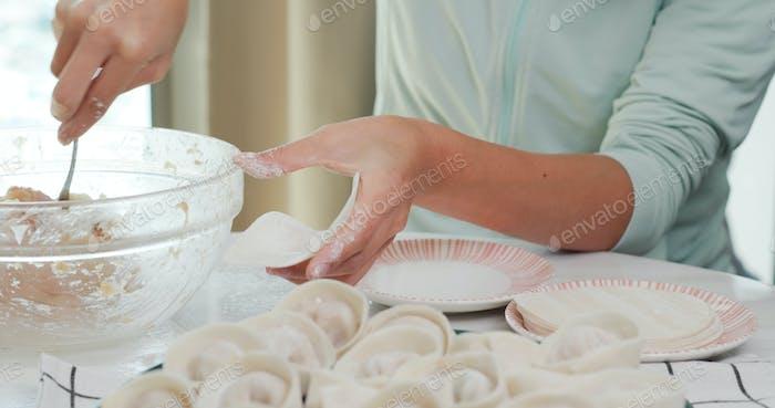 Woman homemade meat dumpling at home