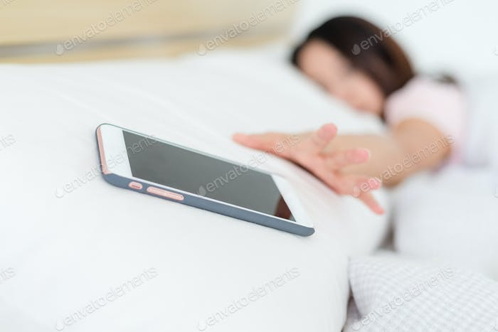 Woman addicted to mobile phone