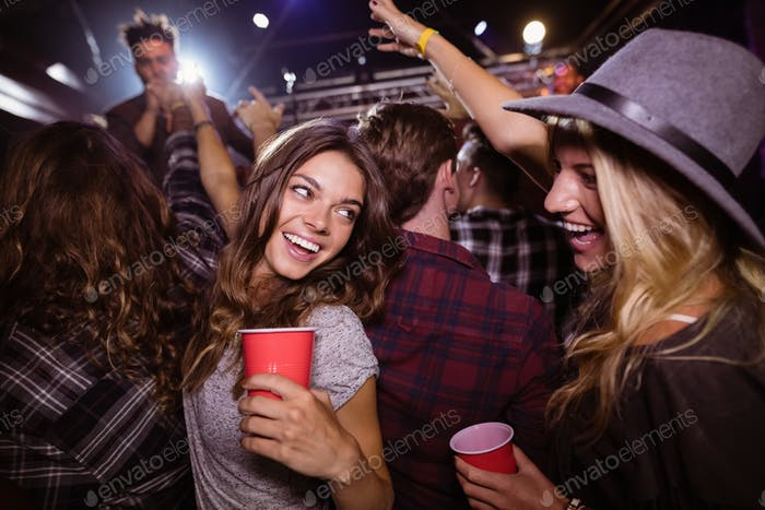 Female friends enjoying music festival