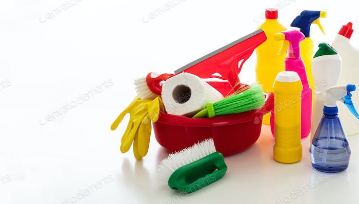 Cleaning supplies and bowl isolated against white background.