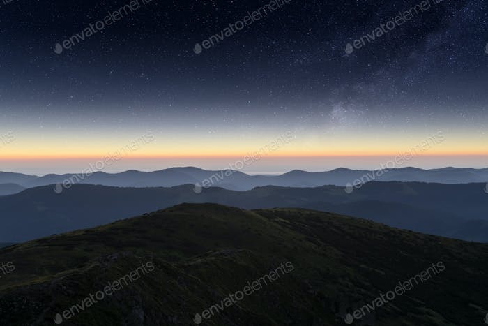 Mountains range against the backdrop of an incredible starry sky
