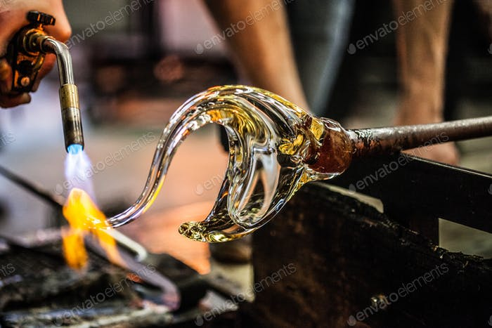 Man Hands Closeup Working on a Blown Glass Piece