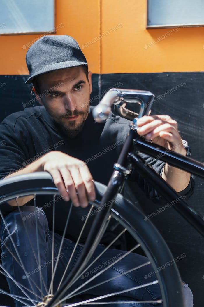Professional craftsman looking at bicycle