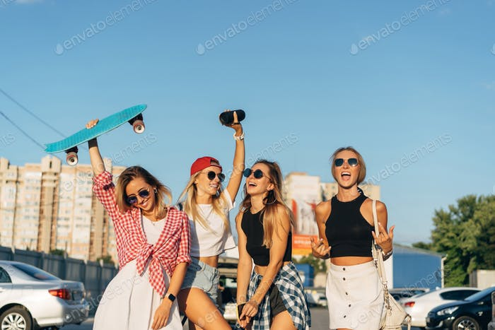 Four young girls have fun at the car park