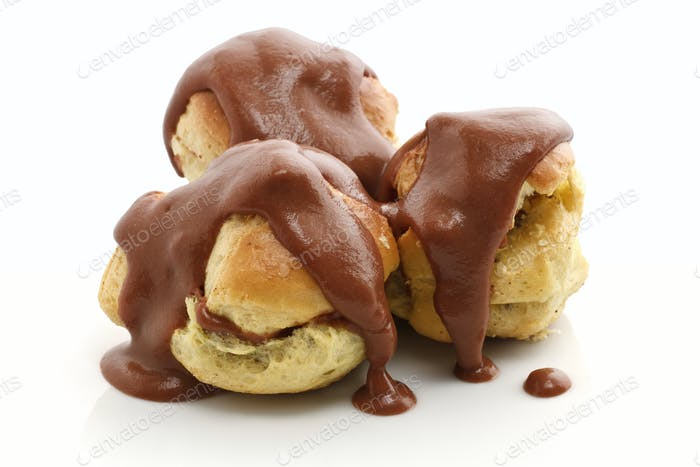 three profiteroles over white