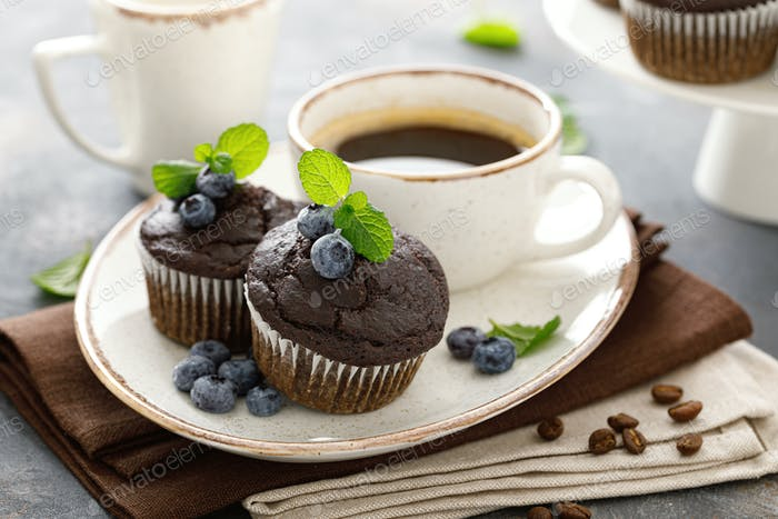 Chocolate muffins with fresh blueberry and coffee cup for breakfast