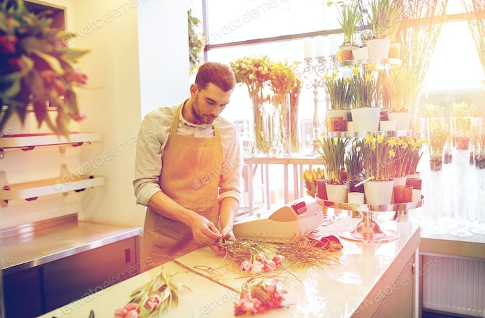 florist man making bunch at flower shop