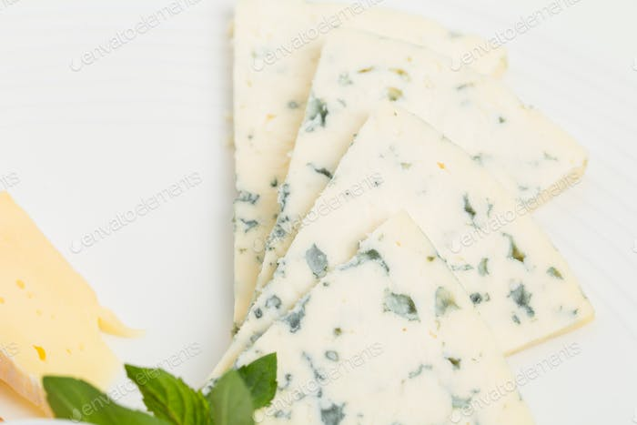 Closeup of delicious sliced roquefort cheese.