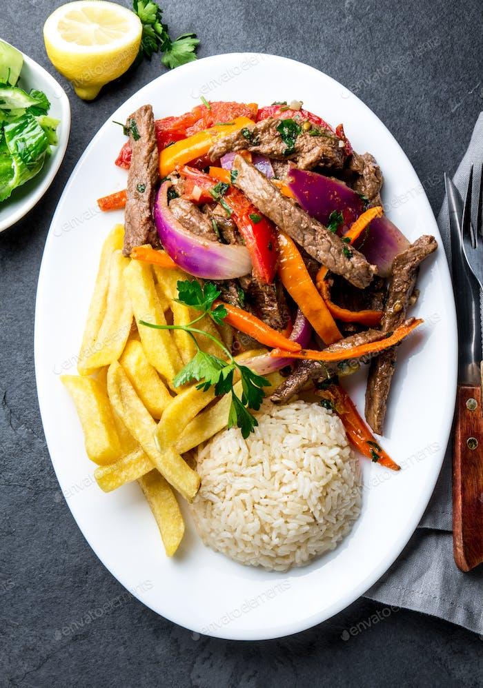 Peruvian dish Lomo saltado - beef tenderloin with vegetables
