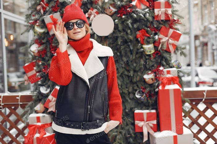 Winter time in big city of charming girl standing on street
