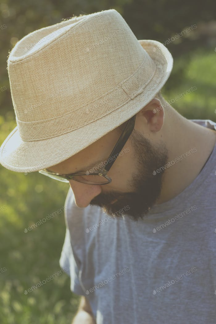 Portrait of a hipster man with a hat