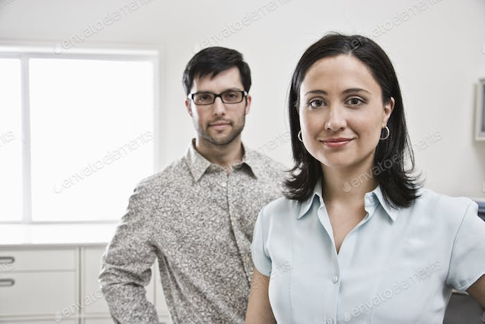 HIspanic woman and man in office.
