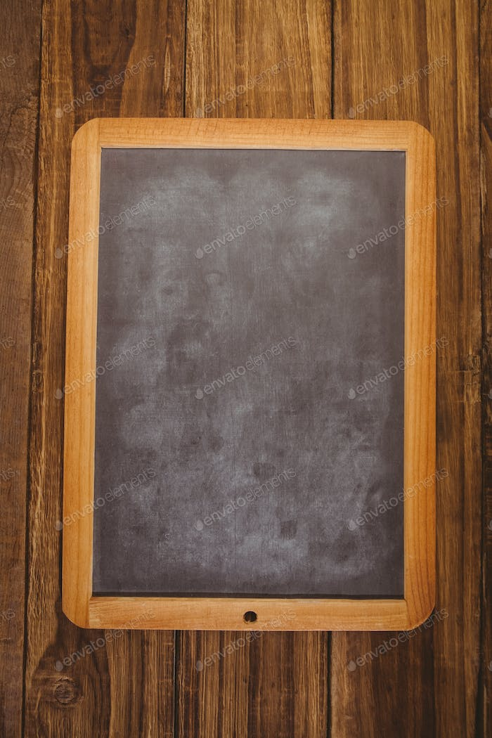 Chalkboard on table with copy space shot in studio
