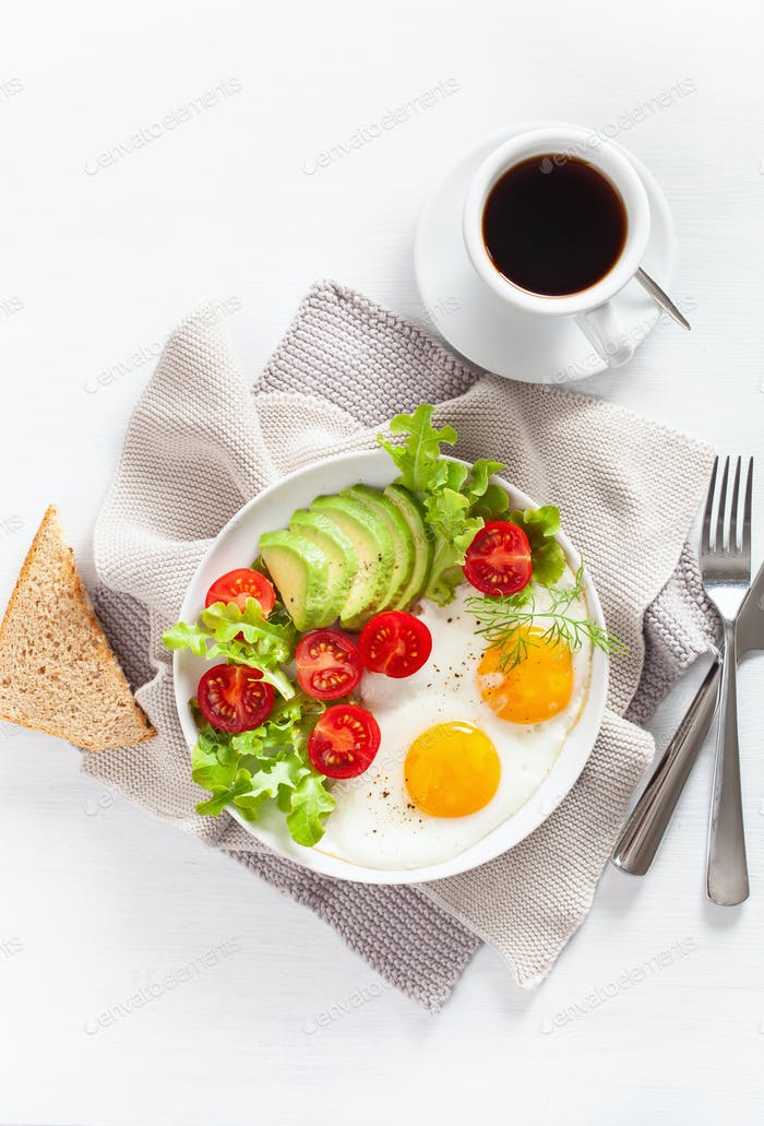 healthy breakfast flat lay. fried eggs, avocado, tomato, toasts