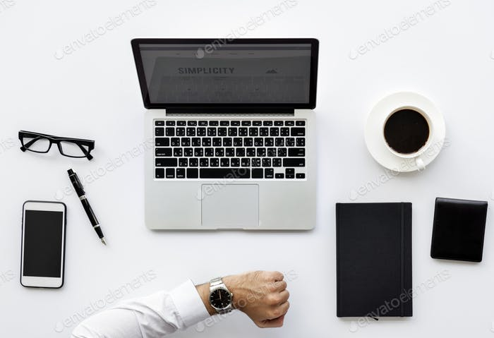 Aerial view of businessman with computer laptop workspace