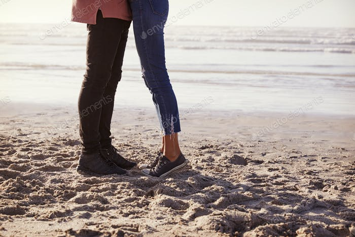 Detail Of Romantic Couple On Walking Along Winter Beach Together