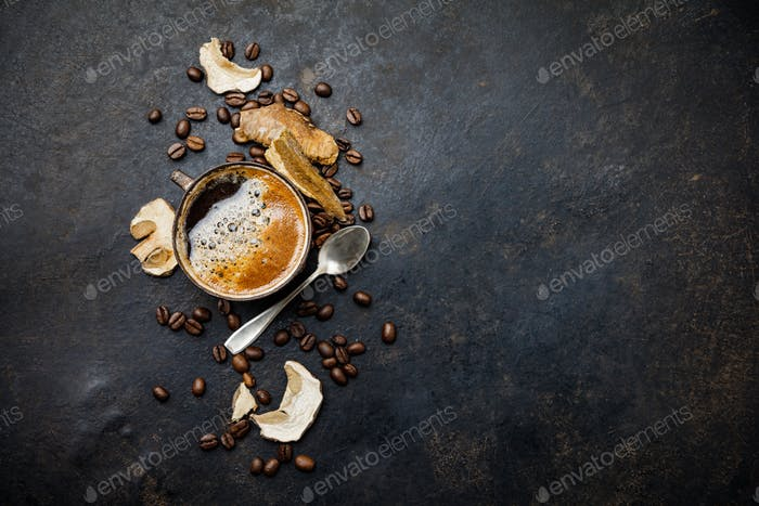 Mushroom Chaga Coffee Superfood Trend-dry and fresh mushrooms and coffee beans on dark background