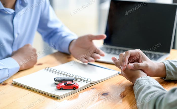 Finance staff are recommending car loans for customers.