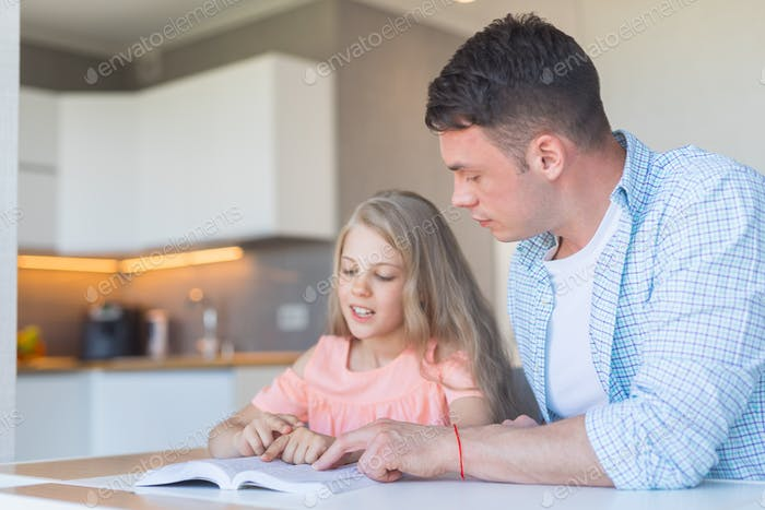 Family reading a book at home