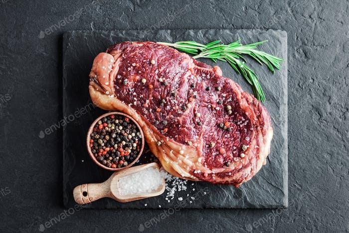 Marbling ribeye steak on slate board