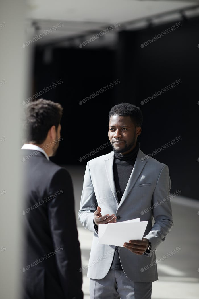 Black businessman talking to colleague