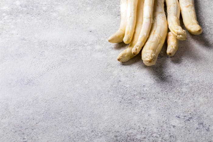 Fresh, white asparagus on a gray background. Healthy eating concept.