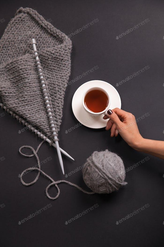 Close-up of knitting on black background