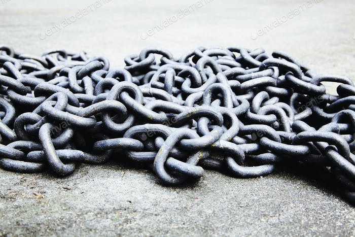 Pile of old chains on the ground