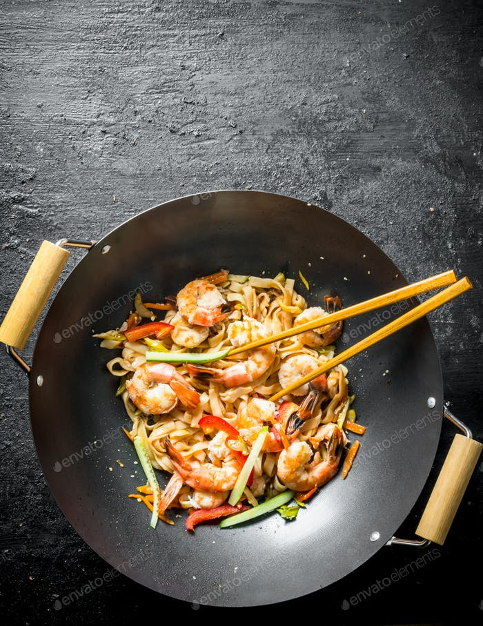 Fragrant Asian Udon noodles in a wok pan.