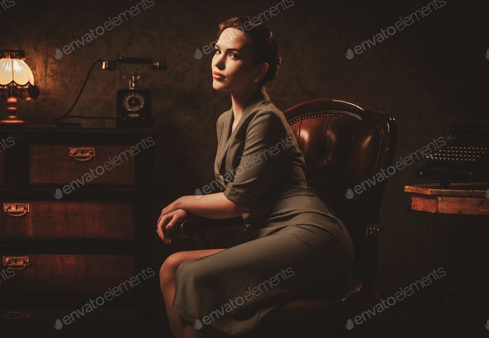 Beautiful young woman in retro interior