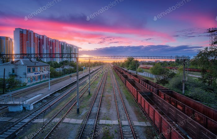 Aerial view of freight trains at sunset. Top view of railroad